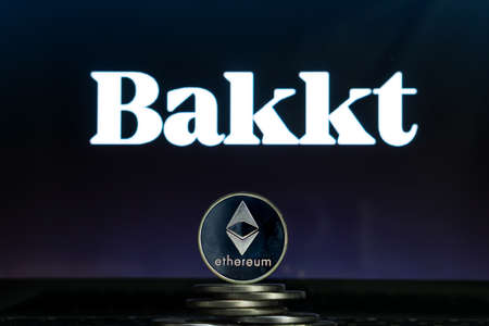 Ethereum coins with Bakkt logo on a laptop screen. Slovenia, Ljubljana - 02 24 2019 Reklamní fotografie - 136926555