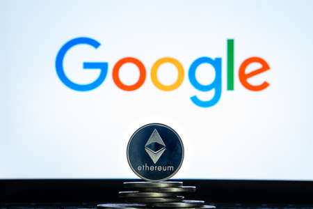 Ethereum coins with Google logo on a laptop screen. Slovenia, Ljubljana - 02 24 2019