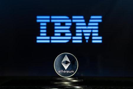 Ethereum coins with IBM logo on a laptop screen. Slovenia, Ljubljana - 02 24 2019 Reklamní fotografie - 136926557