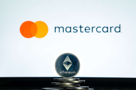 Ethereum coins with Mastercard logo on a laptop screen. Slovenia, Ljubljana - 02 24 2019 Reklamní fotografie - 136926559