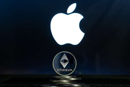 Ethereum coins with Apple logo on a laptop screen. Slovenia, Ljubljana - 02 24 2019