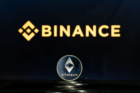 Ethereum coins with Binance logo on a laptop screen. Slovenia, Ljubljana - 02 24 2019