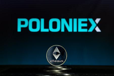 Ethereum coins with Poloniex logo on a laptop screen. Slovenia, Ljubljana - 02 24 2019 Reklamní fotografie - 136926529