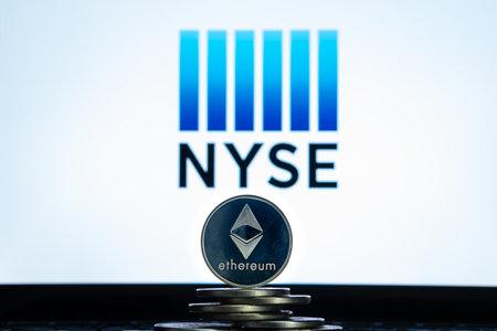 Ethereum coins with NYSE logo on a laptop screen. Slovenia, Ljubljana - 02 24 2019 Reklamní fotografie - 136926532