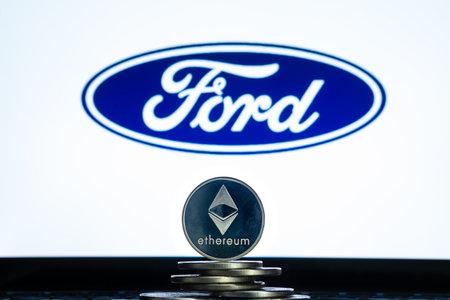 Ethereum coins with Ford logo on a laptop screen. Slovenia, Ljubljana - 02 24 2019 Reklamní fotografie - 136926533