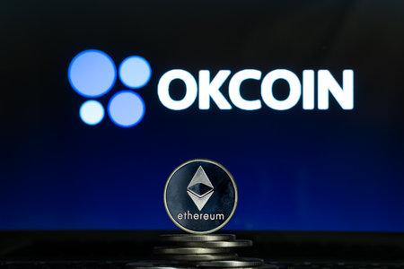 Ethereum coins with OKCoin logo on a laptop screen. Slovenia, Ljubljana - 02 24 2019 Reklamní fotografie - 136926534