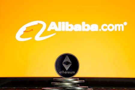 Ethereum coins with Alibaba logo on a laptop screen. Slovenia, Ljubljana - 02 24 2019 Reklamní fotografie - 136926537