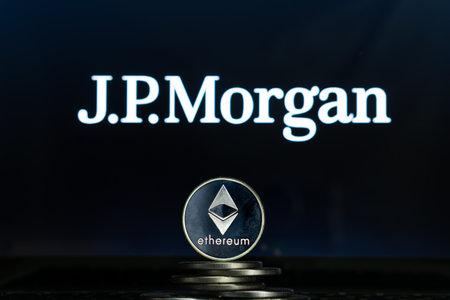 Ethereum coins with JPMorgan logo on a laptop screen. Slovenia, Ljubljana - 02 24 2019 Reklamní fotografie - 136926538