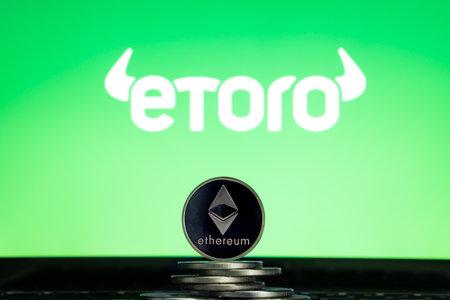 Ethereum coins with eToro logo on a laptop screen. Slovenia, Ljubljana - 02 24 2019 Reklamní fotografie - 136926539