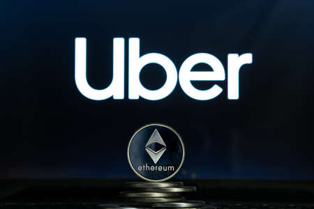 Ethereum coins with Uber logo on a laptop screen. Slovenia, Ljubljana - 02 24 2019