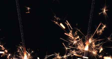Firework sparkler burning on black background. Merry Christmas and happy new year celebration 免版税图像