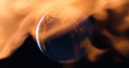 Burning planet earth global warming disaster or sun activity causing devastating solar flare concept