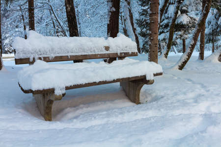 Snowy Bench at Lake Jasna in Winter near Kranjska Gora, Slovenia.
