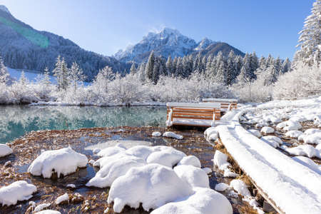 Zelenci Springs nature reserve near Kranjska Gora, Slovenia in Winter. Sunny morning with fresh Snowfall. Sava Dolinka river source. Stock Photo