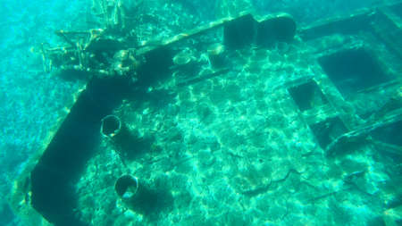 Shipwreck under water, very old ship taken on the bottom of the sea