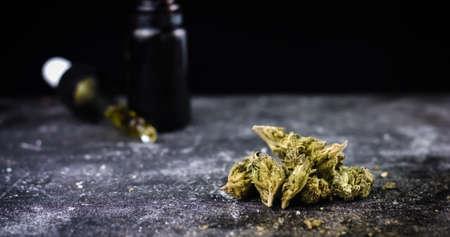 CBD Hemp oil in a droplet with Cannabis Buds. Alternative Medicine Stock Photo