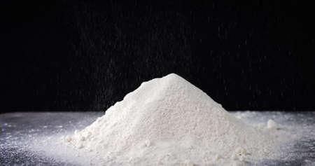 Pile of white flour on black background Reklamní fotografie