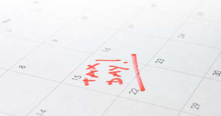 2020 April 15 marked on calendar for tax day reminder deadline with 1040 form. Reklamní fotografie