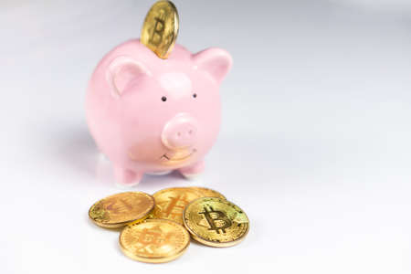 Pink Piggy bank with Bitcoin coin on white background Reklamní fotografie