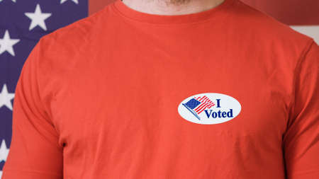 Man putting on I Voted Today button for Presidential election 2020 in America. Reklamní fotografie