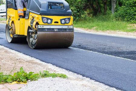 Fresh black asphalt on new street road. Construction at work.