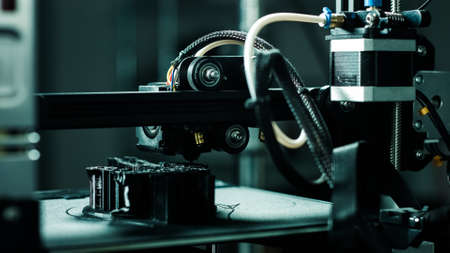 3D printer working in a factory printing plastic part.