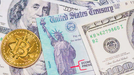 Buying bitcoin with american stimulus check and dollars. Reklamní fotografie