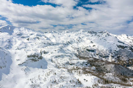 High mountains under snow in the winter for alpine skiing. Aerial view with drone.