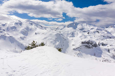 High mountains under snow in the winter for alpine resort skiing. Aerial view with drone.