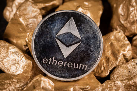Ethereum cryptocurrency with gold nuggets. Investment and store of value concept.