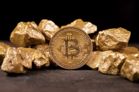 Bitcoin cryptocurrency with gold nuggets. Investment and store of value concept. 版權商用圖片
