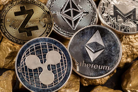 Cryptocurrency altcoins with gold nuggets. Investment and store of value concept.
