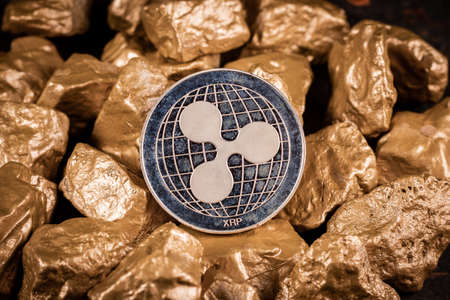 Ripple XRP cryptocurrency with gold nuggets. Investment and store of value concept.