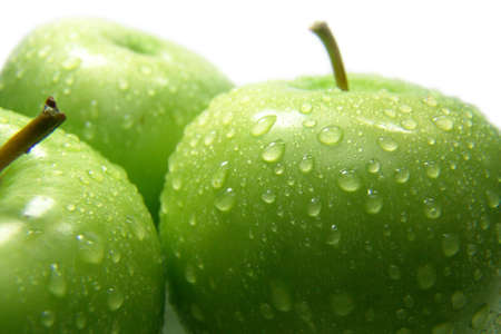 three green apples whith drops of water