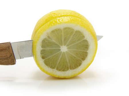 sours: Fresh lemon knife on a white background.
