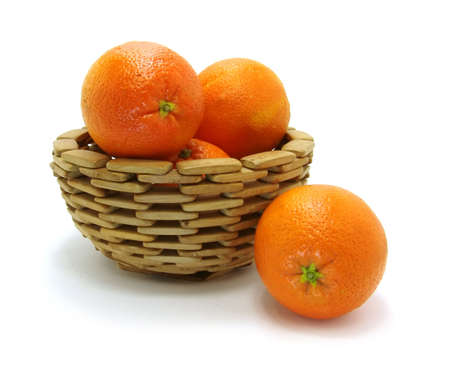 oranges in wooden bowl on a white background