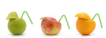 pear, orange and apple whith flexible straws on a white background