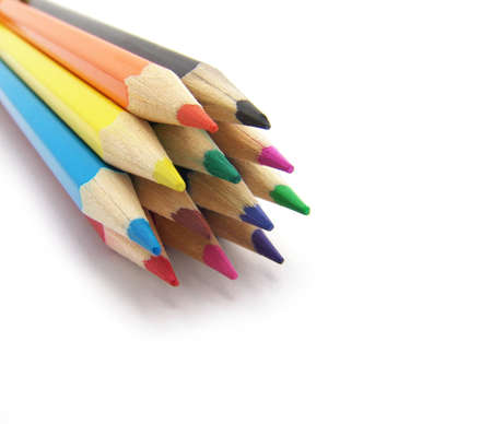 Colored pencils on a white background. Close-up. Macro               photo