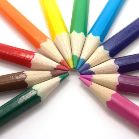 Colored pencils on a white background. Close-up. Macro.                    photo