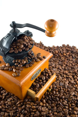 caf: coffebeans and grinder on a white background