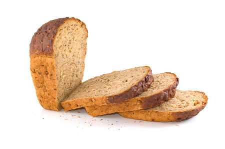 Slices of bread with seeds of sunflower and sesame. White background. photo