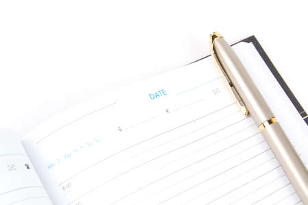Appointment book and pen on a white background. Close-up. Macro. Stock Photo - 6450439