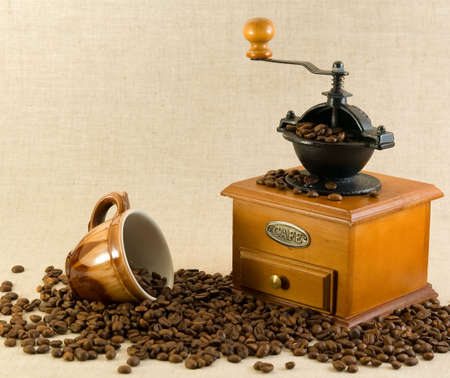 coffee, cup and grinder on a fabric background photo