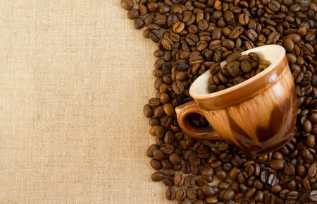 Coffe and cup on a fabric background. Stock Photo