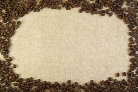 Coffee background - coffee beans on burlap