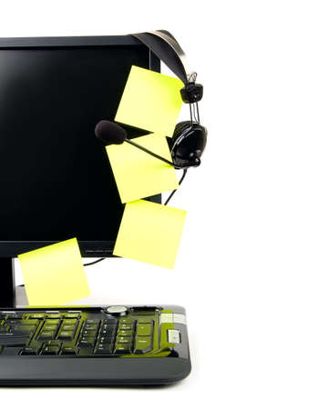 Computer with VOIP headset hanging on the screen, isolated on white background. Internet communications, VOIP (Voice Over Internet Protocol), call-center concepts.