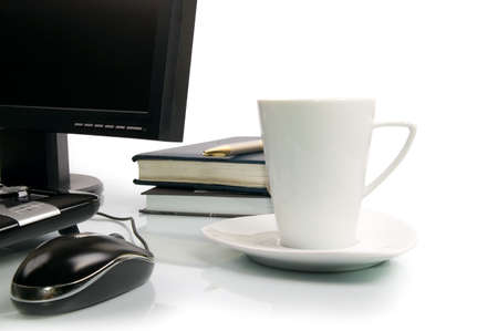 white cup of coffee and computer.