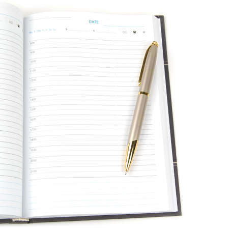 empty appointment book and pen on a white background. Stock Photo - 6450525