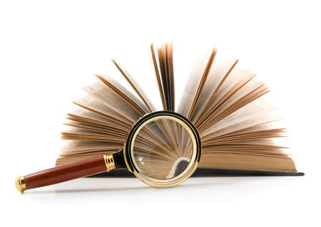 Magnifying glass and opened book, isolated on white background. photo