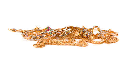 Pile of Gold Jewelry on a white background Stock Photo
